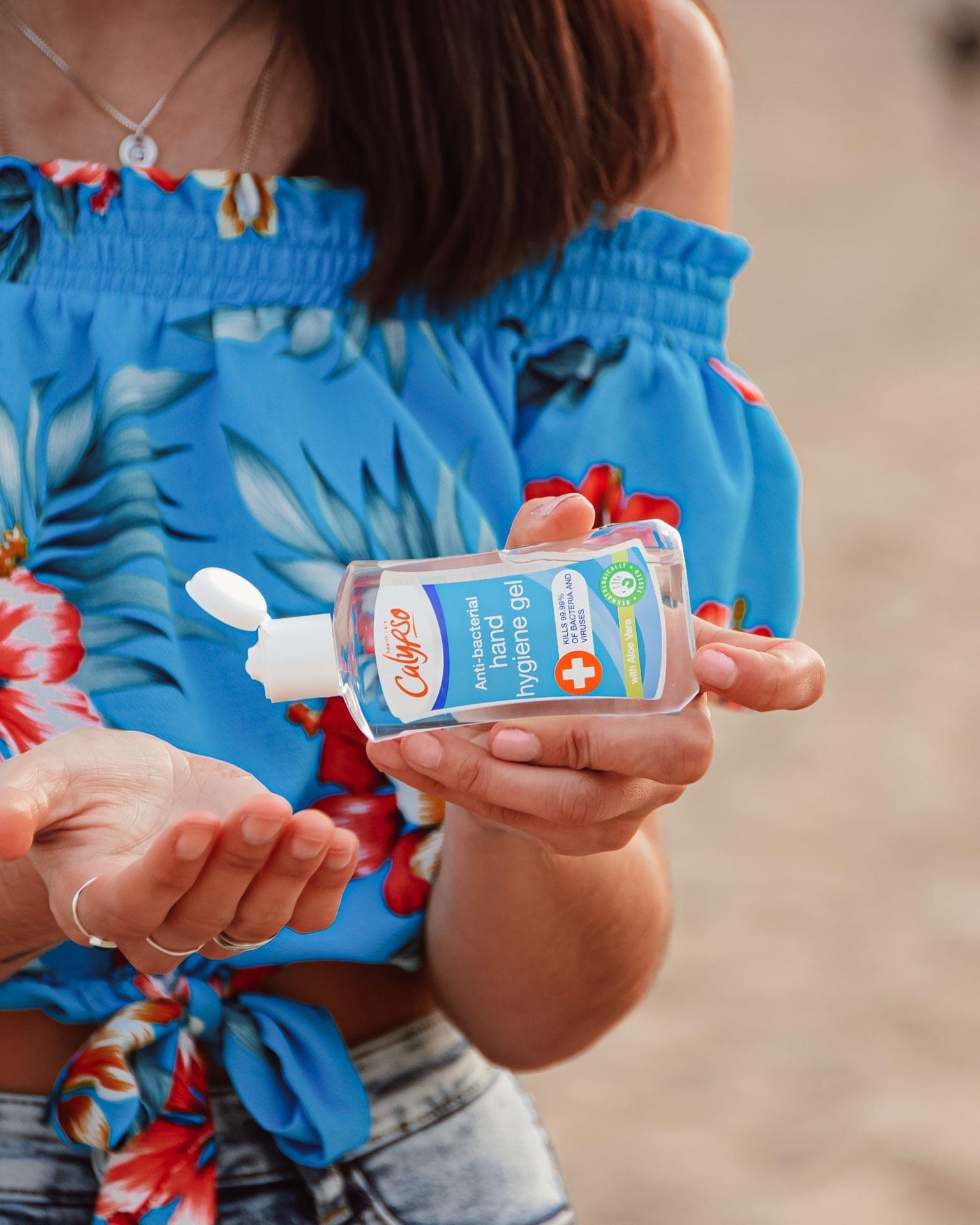Calypso Hand Hygiene Gel 100ml use on a beach