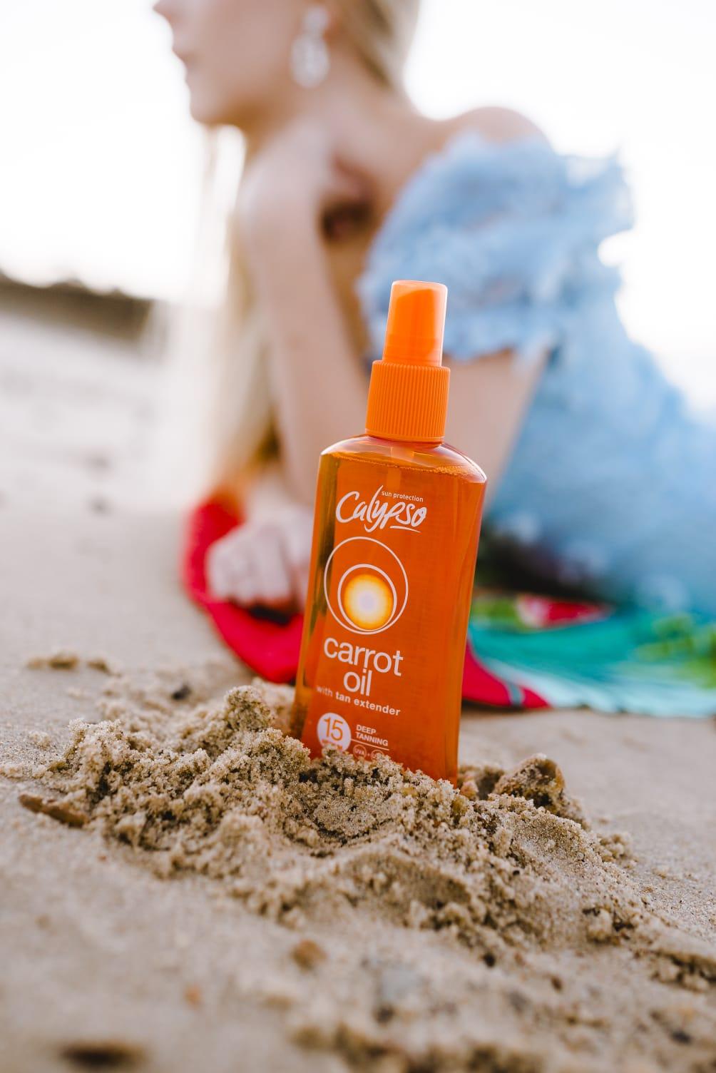 Calypso tanning carrot oil SPF 15 beach sand
